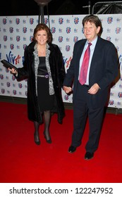 Cilla Black and John Madejski at the Viva Forever Press Night, London. 11/12/2012 Picture by: Simon Burchell