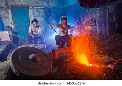 Cimahi, West Java, Indonesia : Traditional Artists making gong, a traditional music instrument, part of gamelan, in his working place in Cimahi, Indonesia (01/2017).
