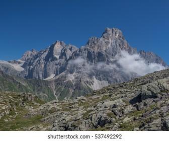 Cimon della Pala, Cima Vezzana, Cima Bureloni, Cima Grandi & Cima Focobon summits of Pale di San Martino range as seen from Tognazza to Cavallazza mountains path, above Rolle pass, Dolomites, Italy