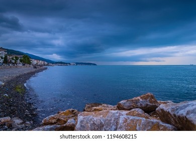 Cinarcik, Turkey - June 9, 2017: Fishermen shelter and seashore establishment by the side of Marmara sea during a calm but cloudy summer evening
