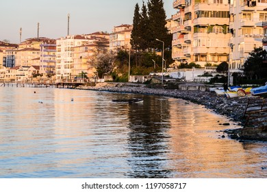 Cinarcik, Turkey - March 29, 2017: Fishermen shelter and seashore establishment by the side of Marmara sea during a calm evening of spring