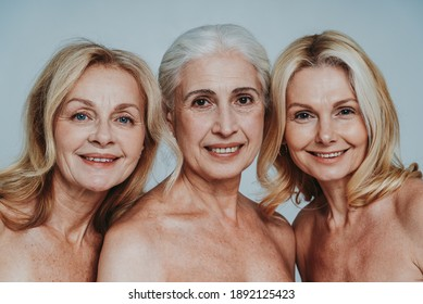 Cincematic image of a beautiful senior women group posing on a beauty photo session. Middle aged women in lingerie on a grey background. Concept about body positivity, self esteem, and body acceptance