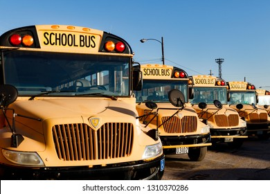 Cincinnati - Circa February 2019: Yellow School Buses in a District Lot Waiting to Depart for Students