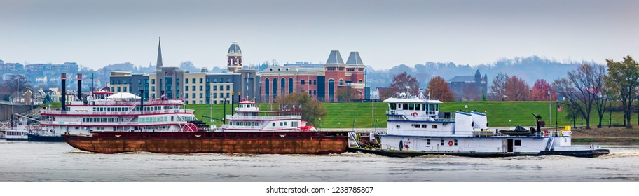 Cincinnati Kentucky riverfront on the Ohio river with tug boats and paddle boats over looking the city sky line Urban exploration photography