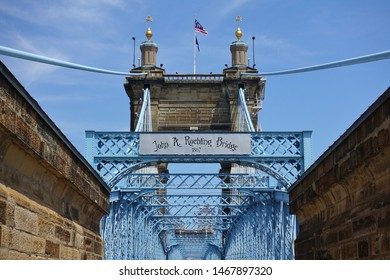 CINCINNATI, OH -13 JUL 2019- View of the blue John A. Roebling Suspension Bridge connecting Cincinnati, Ohio to Covington, Kentucky.