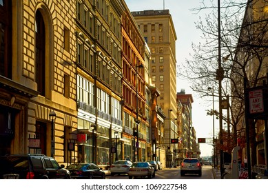 CINCINNATI, OH - APRIL 12, 2018: Fourth West Street in downtown Cincinnati glows golden in evening sunlight on a variety of vintage facades and exteriors.