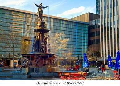 CINCINNATI, OH - APRIL 12, 2018: The Tyler Davidson Fountain, titled The Genius of Water, is the centerpiece of this city's main plaza. The bronze statue was dedicated in 1871 and refurbished in 2006.
