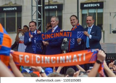 CINCINNATI, OH - MAY 29, 2018: (L-R) John Cranley, Carl H. Lindner III, Jeff Berding and Don Garber unveil the MLS scarf for FC Cincinnati at Fountain Square.