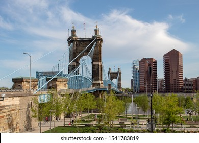 Cincinnati, Oh / USA - April 22, 2019: The famous Smale Riverfront Park, The  Roebling Suspension Bridge and the Kentucky side of the Ohio river.