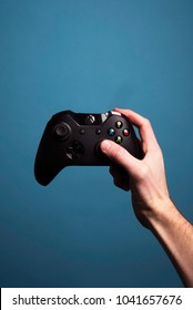 CINCINNATI, OH, USA - CIRCA 2018: Hand holding a black Xbox 360 wireless video game controller.