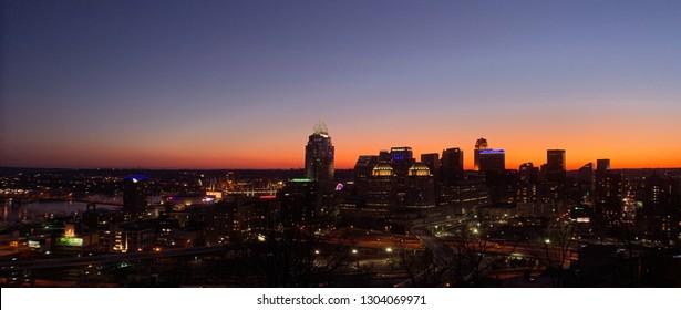 Cincinnati, OH / USA - January 27 2019: Panoramic wide anamorphic shot of the Cincinnati skyline at sunset/dusk from Mount Adams.