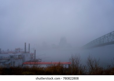 cincinnati, Ohio and covington Kentucky riverfront and skyline with bridges in the fog on a misty day