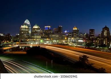 Cincinnati, Ohio - July 30, 2015: View of the Cincinnati skyline and I-71 traffic at dusk. Cincinnati is the 3rd largest city in Ohio and 65th largest city in the USA.