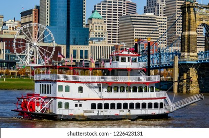 Cincinnati Ohio river front boat  and city scape on a beautiful day looking from Covington Kentucky urban exploration photography