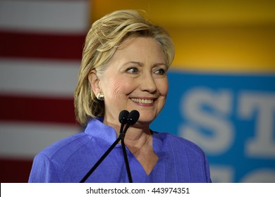 CINCINNATI, OHIO, USA - JUNE 27, 2016: Hillary Clinton smiling in a blue suit speaks at a campaign event at the Museum Center.