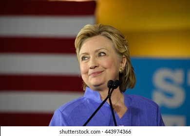 CINCINNATI, OHIO, USA - JUNE 27, 2016: Hillary Clinton in a blue suit speaks at a campaign rally at the Museum Center. Senator Elizabeth Warren joined her for their first campaign event of 2016.