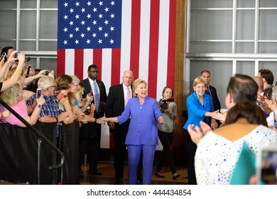 CINCINNATI, OHIO, USA - JUNE 27, 2016: Hillary Clinton and Elizabeth Warren walk from backstage to the podium for their first joint campaign event at the Museum Center.