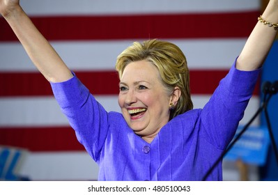 CINCINNATI, OHIO, USA - JUNE 27, 2016: Hillary Clinton victory gesture with raised arms at a campaign event in the Museum Center with Senator Elizabeth Warren.