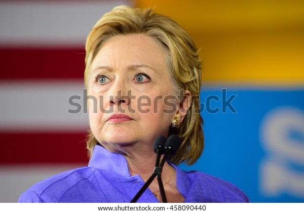 CINCINNATI, OHIO, USA - JUNE 27, 2016: Hillary Clinton with a pensive expression speaks at a campaign event at the Museum Center during a joint appearance with Senator Elizabeth Warren.