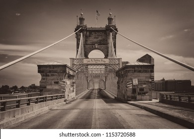 CINCINNATI, OHIO/USA - JULY 6, 2018: Historic John A. Roebling Suspension Bridge in Cincinnati, Ohio in sepia