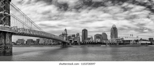 CINCINNATI, OHIO/USA - JULY 6, 2018: Cincinnati skyline, the Ohio River and the John A. Roebling Suspension Bridge