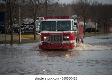 CINCINNATI, OHIO/USA - MARCH 16, 2015 A fire truck drives through floodwaters on Kellogg Avenue in Cincinnati, Ohio,