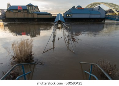 CINCINNATI, OHIO/USA, MARCH 16, 2015: Floodwaters from the Ohio River submerge the entrance to the Beer Sellar and Hooters restaurants across the river from Cincinnati, Ohio.