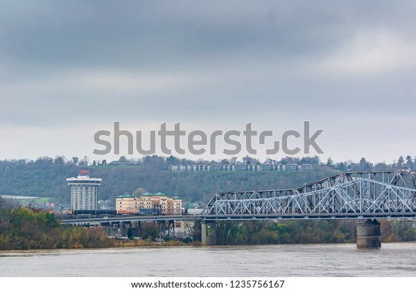 Cincinnati Roebling bridge connecting Covington Kentucky directly downtown Cincinnati Ferris wheel and cityscapes on a cold November morning the 15th 2018 Urban city photography