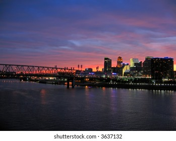 Cincinnati skyline and Ohio River during sunset.