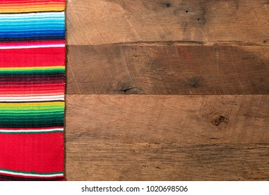 Cinco de Mayo background image on with serape cloth blanket on wooden rustic boards