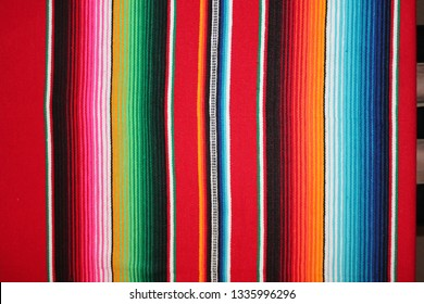 cinco de mayo Mexican poncho Mexico background blanket rug fiesta traditional serape  cinco de mayo poncho with stripes copy space - stock photo photograph