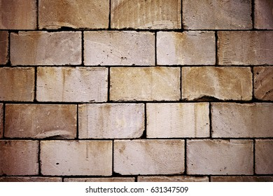 Cinder block wall background, brick texture. Intentional colour shift.