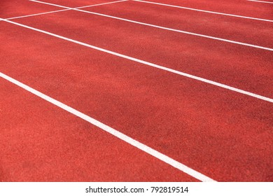 Cinder track in detail in the summer in a stadium