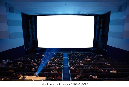 Cinema auditorium with people in chairs watching movie. Light of projector. High angle. Frontal view. Ready for adding your own picture.