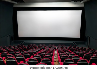 Cinema auditorium with white screen and red and black seats 08.03.2019 Kiev, Ukraine.