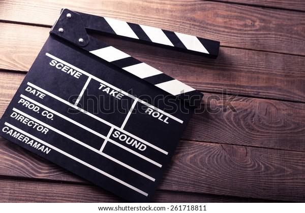 Cinema, clapboard, director.