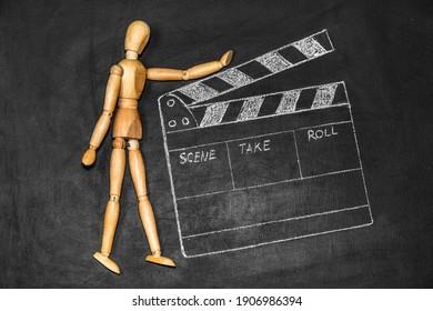 cinema clapper board drawn on the blackboard