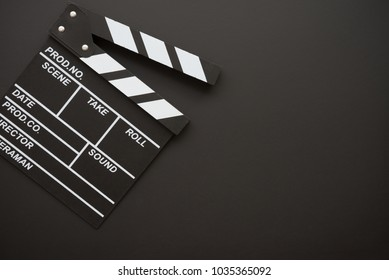 Cinema clapperboard on blackboard background - Movie entertainment concept