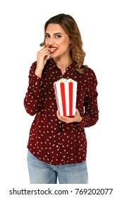 Cinema concept. Woman with popcorn in her hands eating popcorn on white isolated background