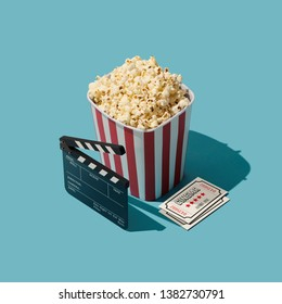 Cinema and entertainment: popcorn, clapperboard and movie theater tickets