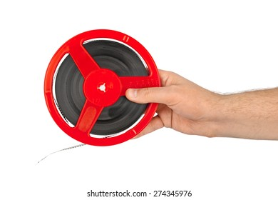 Cinema film reel in hand isolated on white background