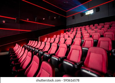 Cinema hall, movie theater, theatre with red armchairs