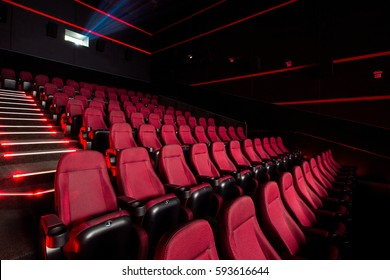 Cinema hall with red armchairs