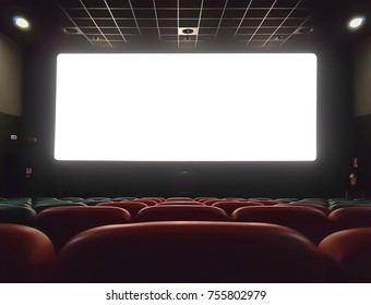 cinema interior of movie theatre with empty red and black seats with copyspace on the screen and glow on edge, concept of recreation and entertainment