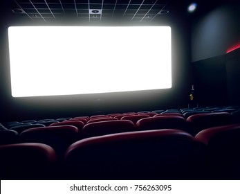 cinema interior of movie theatre with empty red seats with copyspace on the screen and glow on edge, concept of recreation and entertainment
