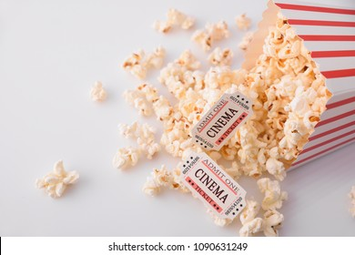 Cinema moments concept with popcorn and movie tickets on white background. Horizontal composition. Top view.
