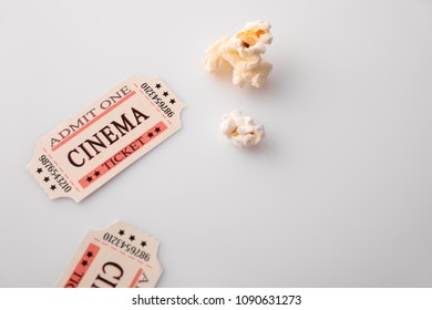Cinema moments concept with popcorn and movie tickets on white table. Horizontal composition. Top view.