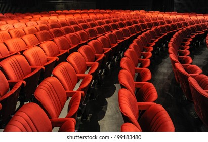 Cinema and music hall with comfortable red seats for audience