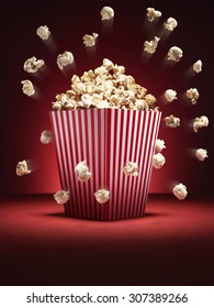 Cinema style popcorn in a traditional box with pieces flying out it a comedy fashion. Vignette effect is naturally created with lighting. There is copy space for the designer at the bottom.