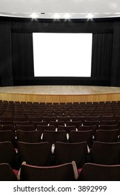 cinema, wooden seats and stage, black screen mask, white empty screen  (1:1,37)